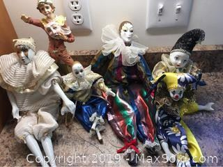 A collection of porcelain and composition clowns