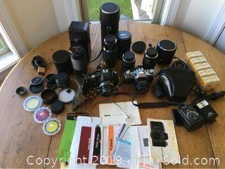 Canon AE 1 Camera, Minolta XE 7, and Sony Video Handycam Hi 8.