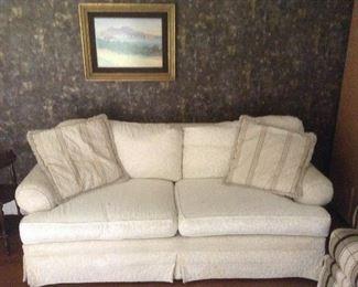 Carson Pirie Scott beige sofa 77L x 32w x31h.