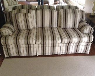 Century taupe, black, beige striped, feather stuffed, sofa with arm covers 85L x 35w x 30h. Excellent condition.