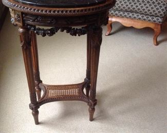 Carved wood and black marble oval side table. 19L x 16w x 28h.