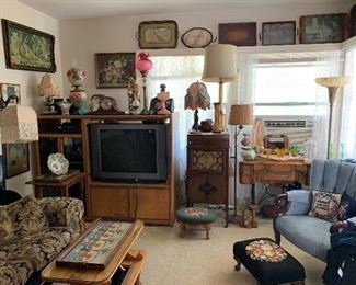 needlepoint footstools, oil lamps, floor lamps, antique trays, antique upholstered chair, New HOme sewing machine,