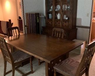 China cabinet, dining room table with four chairs, two leaves, and table pads