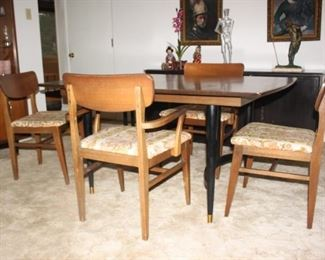 Mid Century dinette set.  Table 4 chairs, two leafs and hutch.  Fantastic condition.