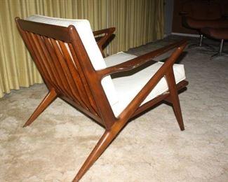 "Amazing hardwood detail.  ""Spear"" shaped details.  Original white Naugahyde upholstery is in great shape."