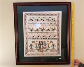 Grandma made many cross-stitch projects and had them professionally framed.