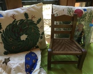 Child's chair and Christmas pillows.