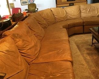Huge leather wrap around sofa.
