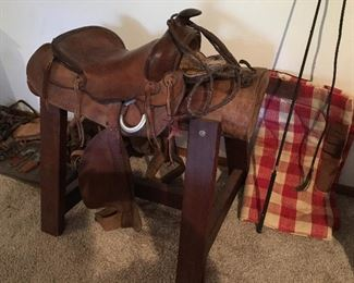Great vintage saddle on handmade saddle tree.  Lots of accessories too: spurs, whips, more.