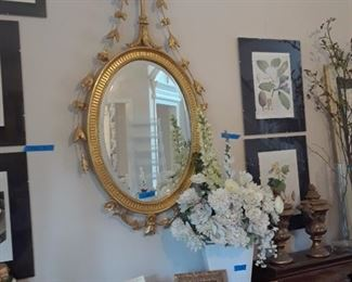 Elaborate oval gilt frame mirror