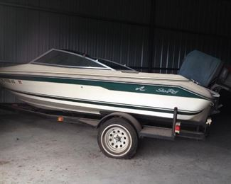 VINTAGE SEA RAY 100 HSP OUTBOARD MOTOR AND OPEN BOW FIBERGLASS BOAT WITH TRAILER.....$1800 or BEST OFFER......SHOWN BY APPOINTMENT ONLY.