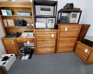 HONEY OAK DESK & 3 CHESTS with DRAWERS (THERE IS ALSO A MATCHING SINGLE HEADBOARD AND A TRIPLE DRESSER not shown in photo)...OLD APPLE COMPUTER...SLIDE PROJECTORS...DUST VAC