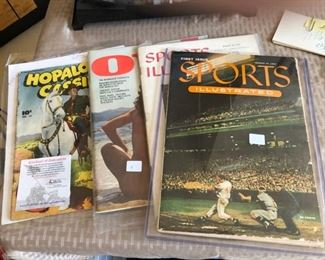 First Edition of Sports Illustrated with intact baseball card insert.  First Edition of Oui magazine.