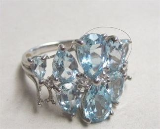 RING MARKED THAILAND 925, MISSING TWO STONES. SIZE 6 3/4