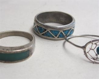 THREE SMALL RINGS: ONE MARKED STERLING WITH INLAID STONE. TWO UNMARKED WITH TURQUOISE COLORED STONES. 6 1/2. 7 1/4 AND 9