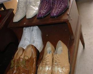 Several pairs of mens designer shoes
