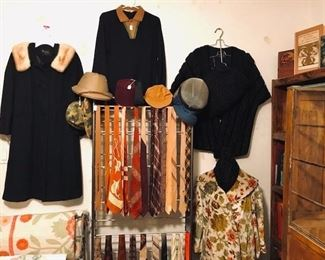 L-R: Vintage wool ladies coat with fur collar, men's Italian merino wool shirt, ladies caracal stole, muff and hat set, ladies floral tapestry swing coat, vintage neckties from the 1930s-1980s, many are silk.