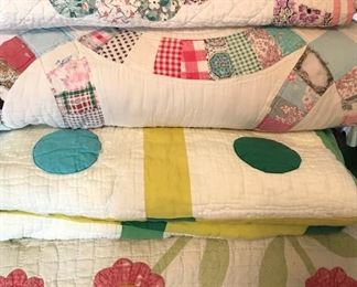 Beautiful handmade antique quilts and some machine made quilts of different sizes and patterns (individually labeled).