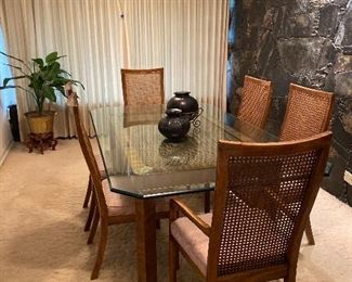BRASS AND BEVELED GLASS TOP DINING TABLE WITH 6 CANE BACK CHAIRS/ OAXACA POTTERY VASES