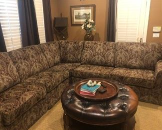 116 inches x 116 inches x 42 inches deep. Great condition, no obvious flaws or wear.  $750.00 Round leather ottoman/cocktail table 41.5 inches round and 23 inches tall. Under shelf Some wear that can be enhanced with leather polish. good condition  $150.00