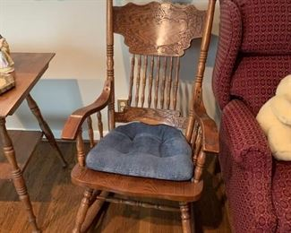 #27(2) Carved Back Wood Rocking Chairs      $65 each