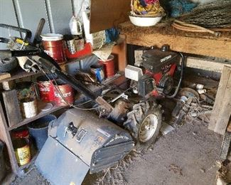 Craftsman 6.0 rototiller. This will get the job done.