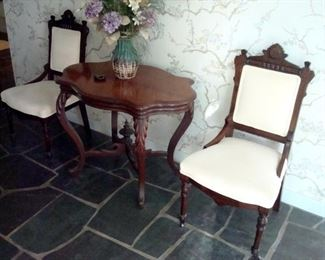 Antique cherry Victorian table and pair Victorian chairs.