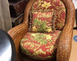 Wicker chair with reupholstered cushion and pillow