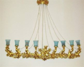 BEYOND Gilt Crown w/ crystal ropes leading to a 10 piece gilt candelabra...shabby chic to the hilt