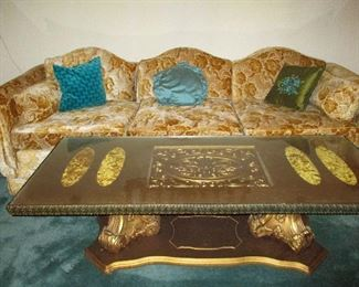 Note the inlaid gold fabric under glass on the tables
