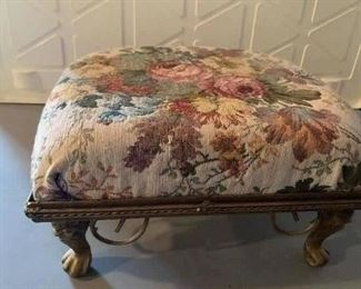 Upholstered metal base footstool.