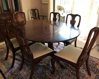 Henkel Harris Oval Dining Room Set To Include -Table with Double Pedestal Base, 4 leaves, pads and 6 upholstered chairs/ 2 upholstered chairs with arms