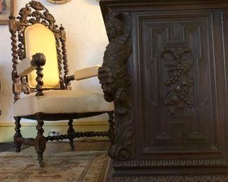 Carved Spanish Revival Armchair, Carved Figural Partners Desk Attributed to R.J. Horner