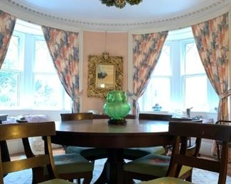 Round Pedestal Table with Six Rounded Back Side Chairs