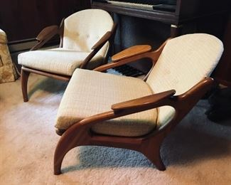 Pr of Mid century Modern chairs in excellent condition.  These chairs have been reupholstered.