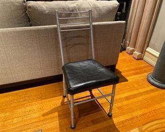 One of four Warren McArthur aluminum tube chairs