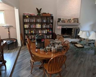 table set, bookcase, books, movies