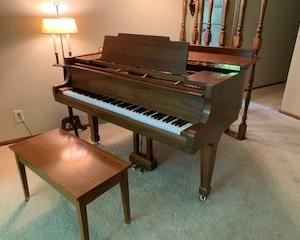 Kawai walnut baby grand piano. (5' long) with bench.