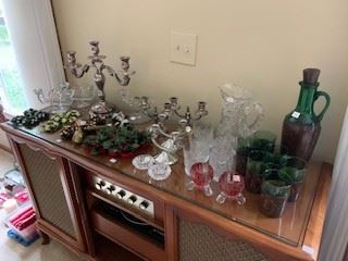 Decanter sets, silver candelabras, silk candle rings and candles (stereo cabinet is sold)