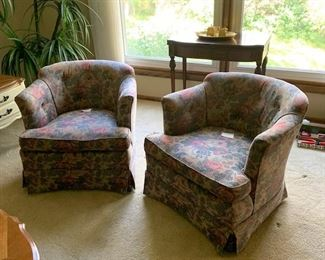 Barrel chairs upholstered in floral tapestry