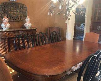 Beautiful Thomasville, Earnest Hemmingway collection, dining table with 2 leaves, burled wood, claw foot.  6 chairs (sold separately).  Shown here with 2 parsons chairs, also sold seperately