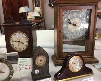General Electric (made in US) Strike GB14, electric (rear left).  Danbury Clock Co quartz mantel clock (front right).