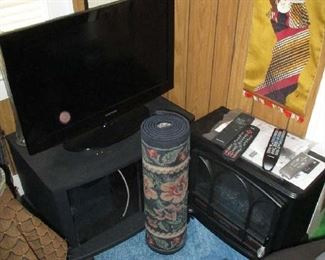 Flat screen TV, rug and household items