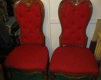 2 of 6 red velvet chairs