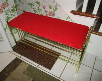 Brass and red upholstered bench