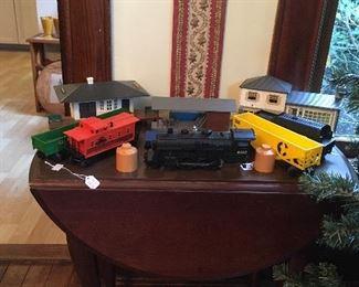 Antique Drop Side Table. Vintage Lionel Train Set.