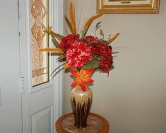 Vase with floral arrangement