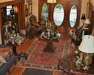 Needlepoint chairs, empire table, oil painting, oriental rug, needlepoint pillows, lamps, blackamoors, needlepoint footstool, walking canes