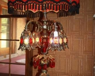 """The """"star"""" of the show.  There is a pair of lamps original to the house.  The shades cover one light bulb.  Inside each of the bell like things are lights of different colors, and the base of the lamp also lights.  It's simply amazing-tall, very heavy, and gorgeous."""