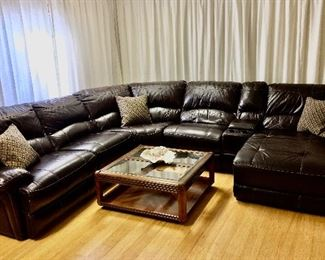 Leather sectional offered by Susie's Key West Estate Sales